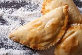 Empanadas On A Table With Flour Spills. Horizontal Top View