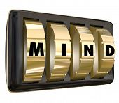 Mind word with letters on lock dials to illustrate a vault of memories or ideas, or unlocking the potential of your brain power to succeed or win in life or career