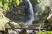 Wooden Bridge And Waterfall