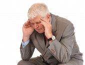 Depressed Mature Businessman Holding Head