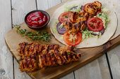 stock photo of shawarma  - grilled chicken shawarma with pita bread and vegetables - JPG