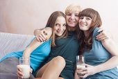 Three Caucasian Young Ladies With Dental Bracket System Having Fun Sitting Together Indoors