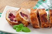 Chicken rolls with cranberries, cheese and honey