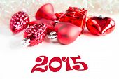 Christmas tree decorations and 2015 sign