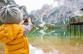 image of south tyrol  - Child taking photo of lake braies in south tyrol italy - JPG