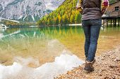image of south tyrol  - Closeup on young woman walking on lake braies in south tyrol italy - JPG