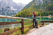 Full Length Portrait Of Young Woman On Lake Braies In South Tyro