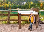 Portrait Of Baby Near Information Board While On Lake Braies In