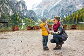 Mother And Baby On Lake Braies In South Tyrol, Italy