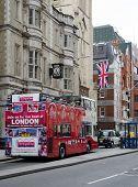 LONDON, UK - APRIL 22, 2014 Modern red double decker bus April 2, 2014 in Strand Street