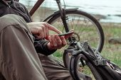 Cyclist searching GPS coordinates on smartphone