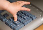 baby's hand on keyboard