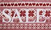 Sale on knitted background