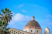 stock photo of michel  - san michele dome under a blue sky in Alghero Italy - JPG