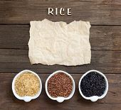pic of wood craft  - Variety of rice with craft paper and word Rice on wood - JPG