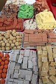 foto of barfi  - View of indian sweets at a market - JPG