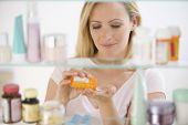 Woman Getting Medicine