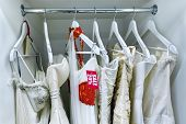 stock photo of fancy-dress  - Sale collection of wedding dresses in the shop at discount - JPG