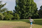 foto of glider  - Young boy throwing  model aircraft glider into skies for flight at home - JPG