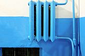 Old vintage iron heater radiator painted in blue lot of copyspace