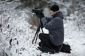Photographer In Winter Outdoors