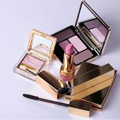 image of lipstick  - Luxury eyeshadow palette with mirror and lipstick in pink and beige colors - JPG