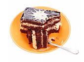 Chocolate cake on orange plate