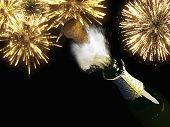 Champagne bottle and cork with lit firework