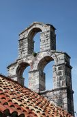 BUDVA, MONTENEGRO - JUNE 09, 2012: The bell tower of the church of Saint Mary in Punta, Budva, Montenegro, on June 09, 2012