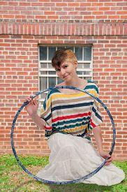 image of hulahoop  - Young beautiful woman with a hula hoop - JPG