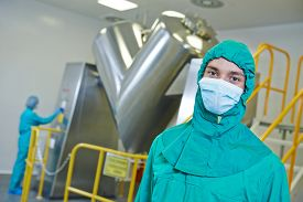 picture of pharmaceuticals  - pharmaceutical factory workers in front of powder mixer machine during tablet production at pharmacy industry manufacture factory - JPG