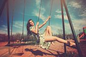 picture of leek  - barefoot young woman sit on swing in summer dress in playing park  - JPG