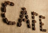 picture of spit-roast  - Roasted coffee beans making the word  - JPG