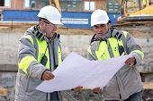 foto of inspection  - Civil Engineers at at construction site are inspecting ongoing production according to design drawings - JPG