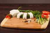 picture of pita  - pita bread with green onion and tomato on a wooden table - JPG