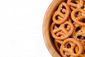pic of pretzels  - Isolated bowl of crunchy pretzels in white background - JPG