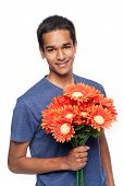 stock photo of mixed race  - Smiling mixed race man holding bunch of flowers - JPG