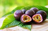 foto of passion fruit  - Passion fruits on wooden table - JPG