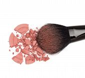picture of blush  - Closeup of crumbled powder blush pink color with makeup brush on white background - JPG