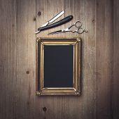 stock photo of barber  - Picture Frame And Vintage Barber Tools on the wood - JPG
