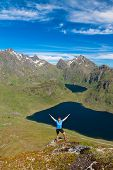 pic of lofoten  - Sporty woman on the top of a mount Holandsmelen - JPG
