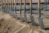 pic of spade  - A number of spades in a groundbreaking ceremony of a new building - JPG