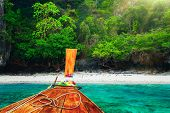 stock photo of koh phi-phi  - Traditional wooden boat in a tropical bay on Koh Phi Phi Island - JPG