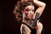 picture of girls guns  - Beautiful sexy girl with gun. Posing in studio. With blood on face and wound.