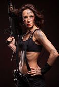stock photo of guns  - Sniper woman in leather sexy wear - JPG