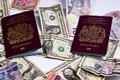 United Kingdom Passports Laying On Foriegn Currency