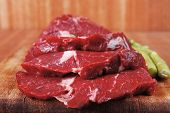 image of veal  - red fresh raw beef veal fillet with asparagus on cutting plate over wooden table prepared to use - JPG