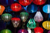 pic of eastern culture  - Night lanterns in old Hoi An town in Vietnam. Background of ancient eastern culture. Multiple colors and bright lights.