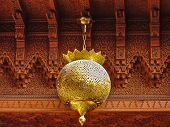 picture of carving  - Traditional Moroccan lantern and cedar wood carved ceiling in Marrakech Morocco - JPG