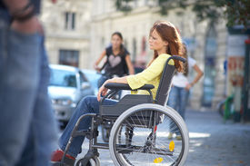 pic of rollator  - lonely girl is sitting on a wheelchair on the street - JPG